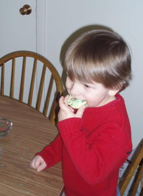 my son eating one of the cookies